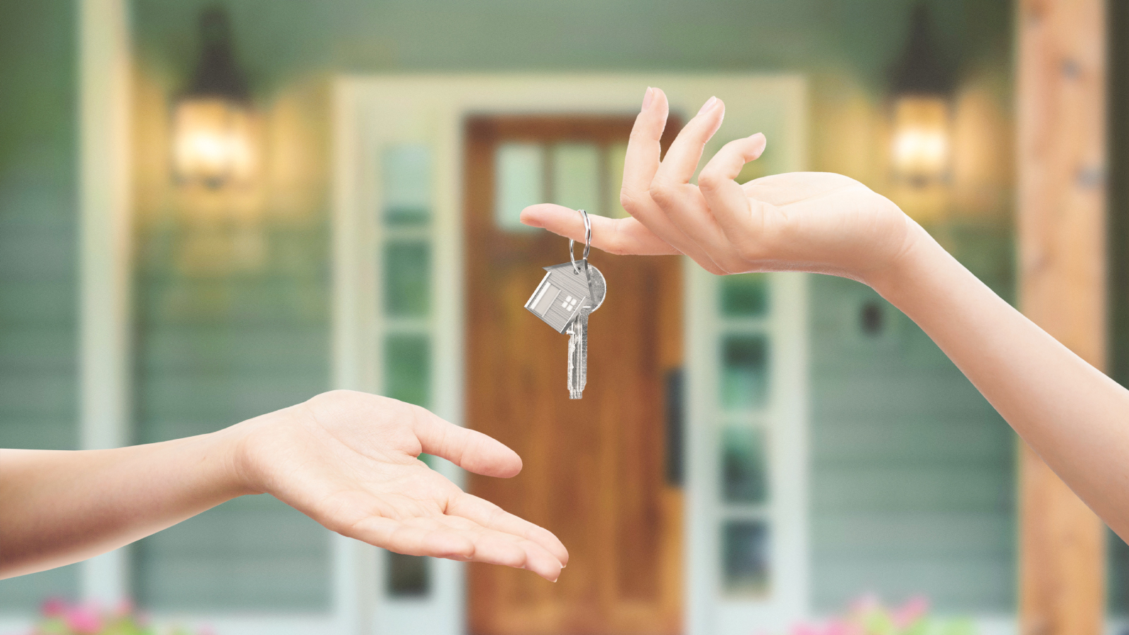 new home with key being exchanged